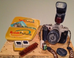 Old Gadgets No. 2: my film-era camera, 1999. Acrylics on board. The prints are from a trip I did to China in 2001. The slides are the only ones I ever took, on a trip to Vietnam in about 1996.