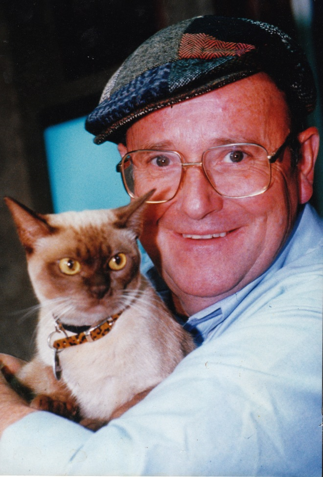 "Australian TV celebrity vet Dr Harry with Babette. His verdict: ""A lovely cat, but she won't be best in show""."