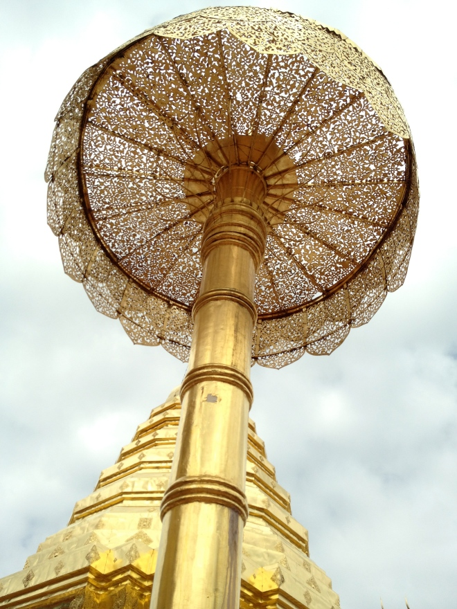 Golden umbrella with intricate lacework at Wat Doi Suthep, near Chiang Mai