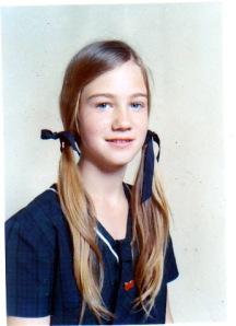 Me as a New Zealand schoolgirl in my blackwatch tartan summer uniform
